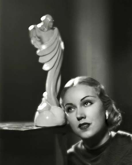 Fay-Wray posing with white art deco sculpture