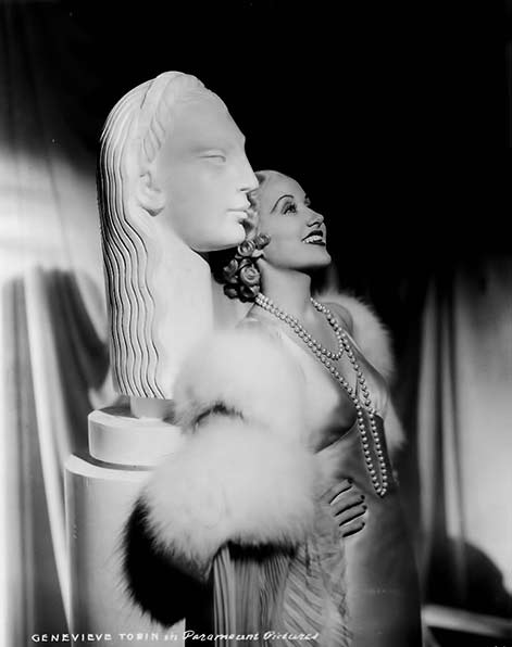 Genevieve-Tobin posing with white art deco bust