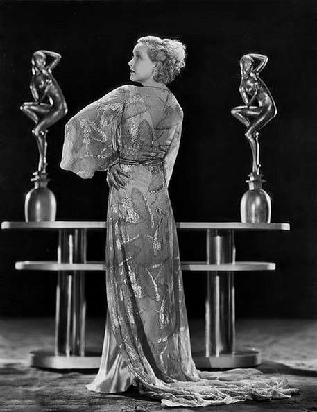 Helen-Twelvetrees posing with to art deco figure sculptures