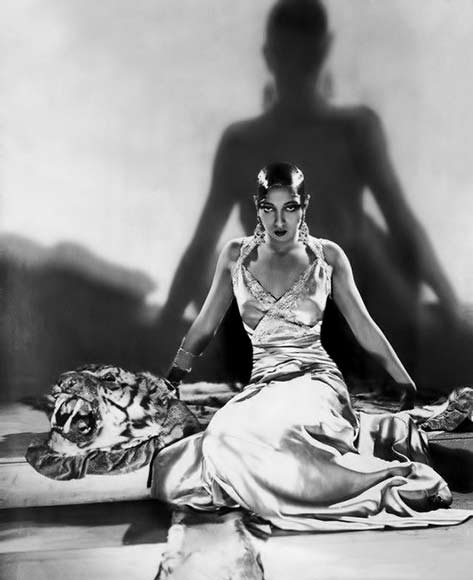 Josephine Baker sitting on tiger skin rug