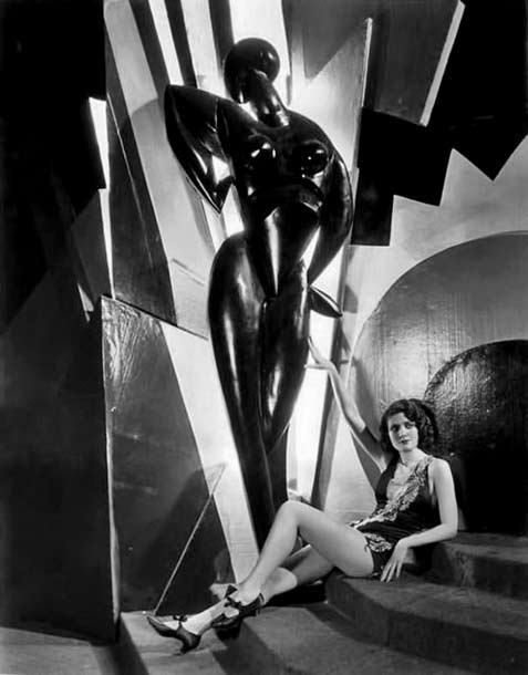 Merna-Kennedy with tall black cubist statue
