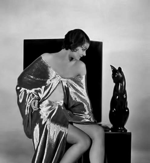 Myrna-Loy with a black cat sculpture