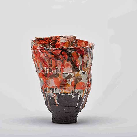 drip glaze footed vase in red, brown and white