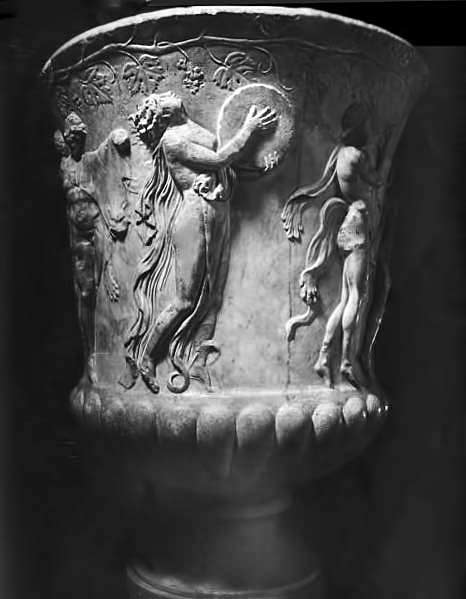 Goblet with bacchanalia celebration relief of woman playing a drum