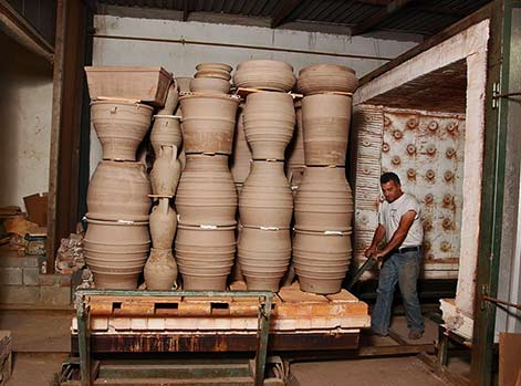 Loading the kiln with large garden pots on a trolly - Cretan-Terracotta Pottery