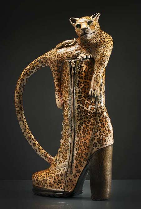 Leopard in a leopard skin boot teapot