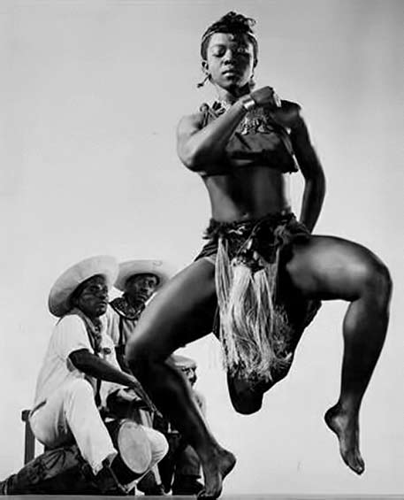 Pearl-Primus dancing with two drummers Photo by Gjon Mili