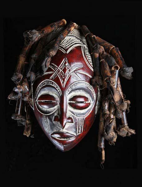 Chokwe-red-and-white braided hair