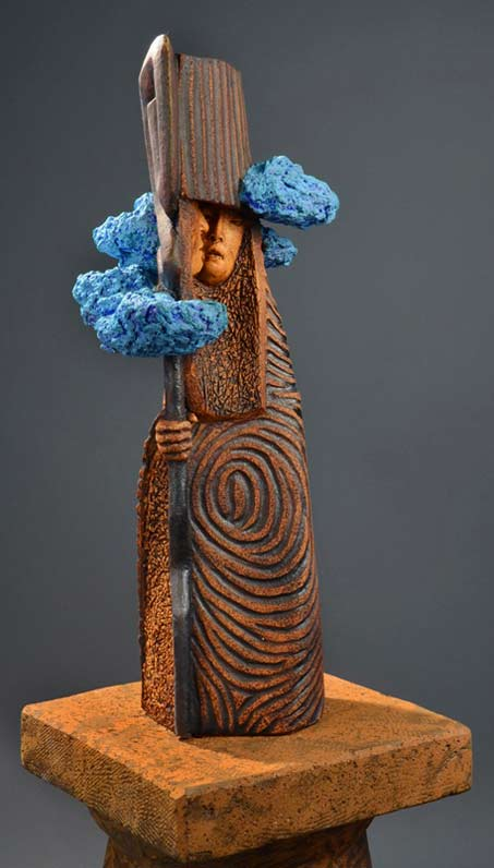 Clayton Thiel_Stone_Sculptures Truth Sayer Shaman in spiral cape and blue clouds