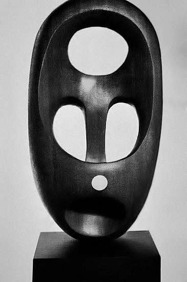 Black sculpture Magic Mask by Elizabeth Catlett