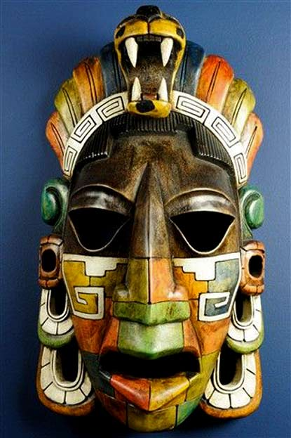 Colourful Mayan mask in green, orange and white