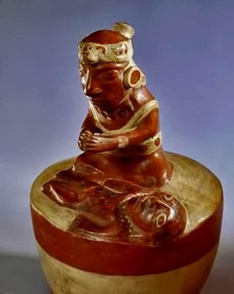 ceramic shaman figure praying