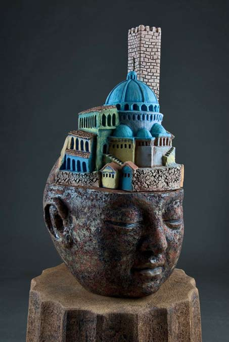 clayton_thiel_bigHeads_Memory Sculpture of a head with arched buildings on top