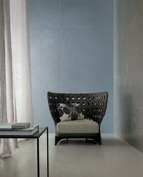 Casa-mood--slate-blue-wall-panels and wicker chair