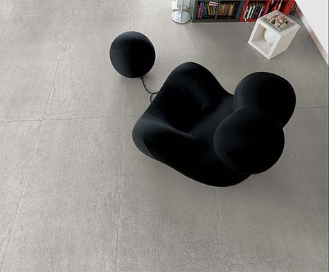 Casamood--textured-floor-tiles and black modern biomorphic chair