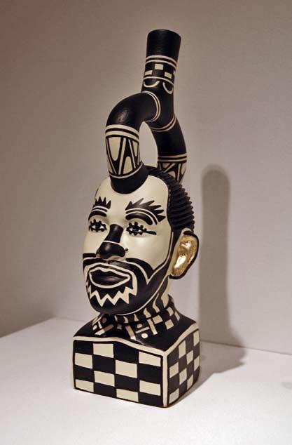 Diego-Romero-ceramic-head sculpture in black-white and gold