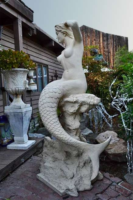 white mermaid on rock sculpture