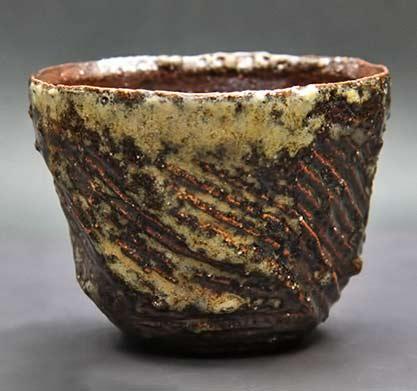 Satoshi-Watanabe-ceramic-tea-bowl with carved texture