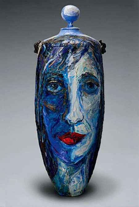 Sue-Averell-and-Joseph-Woodford lidded ceramic vessel with blue face motif