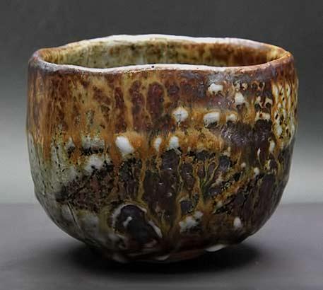 Takadai-tea-bowl in earthy tones of brown and yelllow