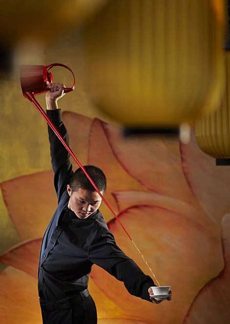 Kong-Fu-tea-master pouring a cuppa Carlton Ritz