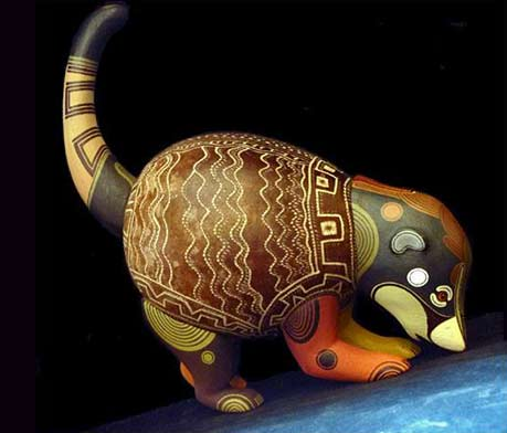Brunka tribe-This spectacular Coatimundi figure made from balsa wood and the 'jícara' fruit shell. Painting by Paco Lazaro Fernandez and carved by his mother Loli Lazaro Fernandez