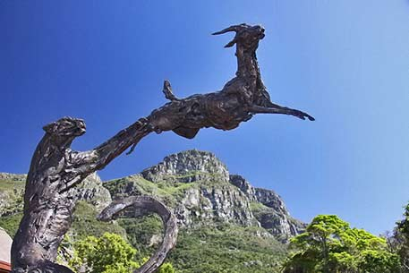 Derek Keats-photo-gazelle and lion-sculpture