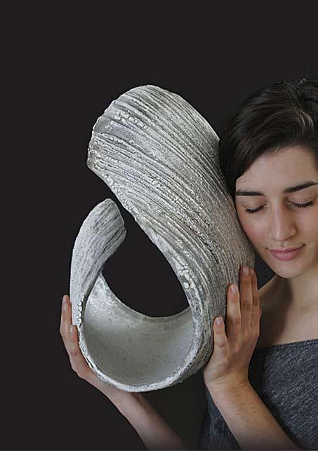 Les Journées de la Céramique - Paris - A girl holding a ceramic sculpture