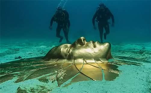 Divers discover ancient solar art head