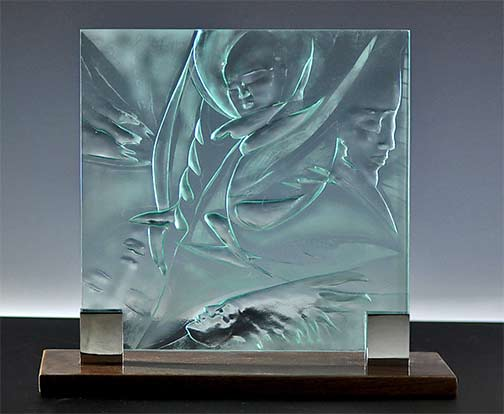 Four Faces---Susan Bloch - carved glass sculpture