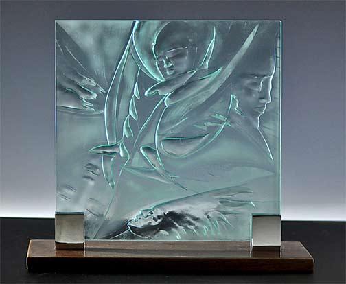 Four Faces---Susan Bloch - carved glass sculpture