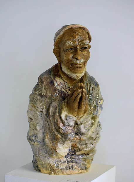 Karen Van Galder man in prayer sculpture
