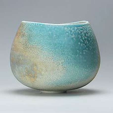 Thrown and altered porcelain bowl by Jack Doherty that he has soda fired in a gas kiln.