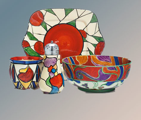 Clarice Cliff-ceramics Comprising-a-platter,-a-centerpiece-bowl-in-the-'Bizarre'-'Persian'-pattern,-and-a-vase,-together-with-a-caster-with-metal-cover