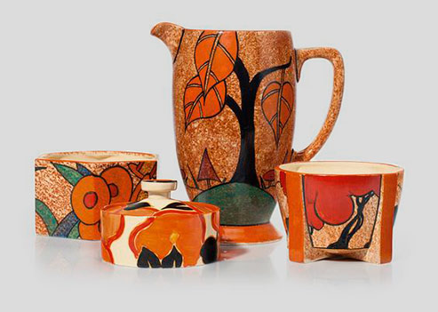group-of-clarice-cliff-decorative-tableware's-Various-patterns-and-shapes-comprising-two-fern-pots,-a-jug,-and-a-jam-pot-and-cover
