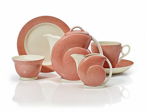 RARE-CLARICE-CLIFF-TEA-SET-In-the-aerographed-pink-color,-nautilus-shape,-comprising-a-teapot,-tea-cup-and-saucer,-side-plate,-sugar-bowl-and-creamer---1936