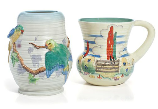 Two-clarice-cliff-vases The first in the 'Love Birds' pattern, the second 'Stile & Trees'