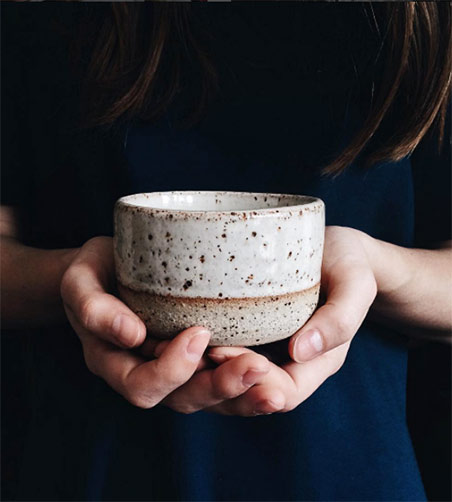 stoneware-tea-cup-with-a-shino-glaze -- Nicolette-Johnson