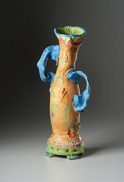 Skewed ceramic vase with blue handles - -Alice Federico