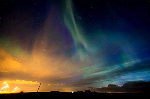 Battle of city, cosmic and morning light-by-Neil Zeller