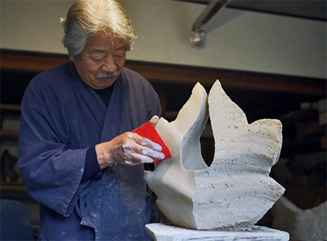 Yasuhisa Kohyama ceramic sculpting in studio