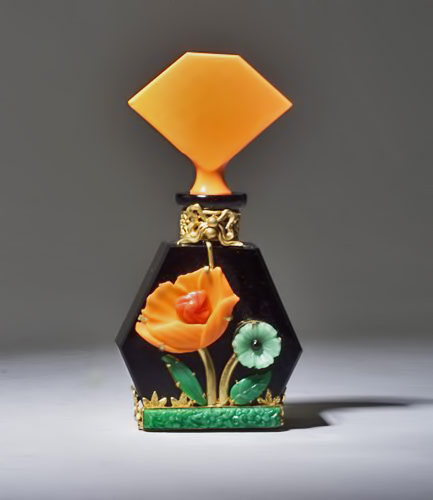Heinrich Hoffman perfume bottle, circa-1920s,-in-opaque black and orange crystal with metalwork and jewels