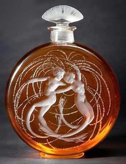 Rene-Lalique-perfume-bottle amber glass with whit dancing female nudes
