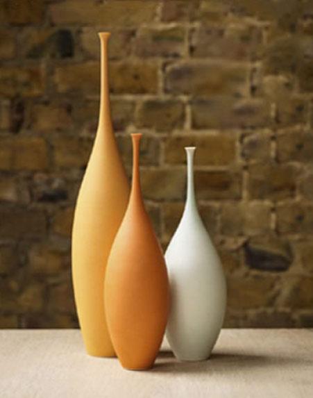 Orange and white ceramic bottles -- Sophie Cook